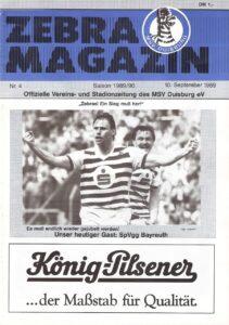 """Während seiner erfolgreichen MSV-Jahre strahlte Michael Tönnies (im Bild vor Ewald Lienen) oft vom Cover der Stadion-Zeitschrift """"Zebra-Magazin"""". Foto: oepb.at"""