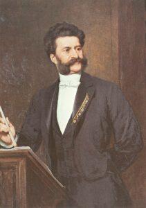Johann Strauß (Sohn) am Dirigierpult als Ölgemälde von August Eisenmenger, entstanden um 1887.
