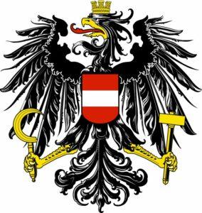 """So sah das Staatswappen der 1. Republik (1919 bis 1934) bei seiner Einführung im Jahre 1919 aus. Nach dem Ende des Zweiten Weltkrieges im Jahre 1945 wurden die """"gesprengten Ketten"""" an den Beinen des Adlers hinzugefügt."""